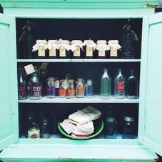 Original green cabinet holding a range of unique kitchenware items - ENQUIRE FOR AVAILABILITY ON STOCK - #vintage #rustic #old #retro #antique #homewares #gifts #tables #furniture #countryhome #countrystyle #Homemadehoney #masonjars #originalmasonjar #milkbottles #oldmilkbottles Old Milk Bottles, Beach Furniture, Green Cabinets, Country Style, Kitchenware, Liquor Cabinet, Mason Jars, Tables, Range