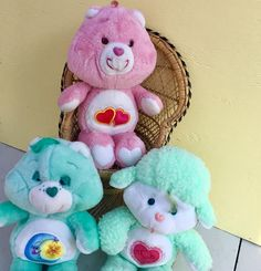 Calling all Care Bear fans! Lot of three to add to your collection, or to start a new one! Included are: -Pink Love-A-Lot Care Bear with two hearts on her tummy -Green Bedtime Care Bear with a moon and star on his tummy -Green Lamb Gentle Heart Bear with a pink heart on her tummy