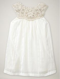 Cute idea--using doilies to make the top of a little girl's dress, then it's just simple to sew on a bottow skirt