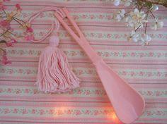 vintage 1950s flamingo pink shoe horn with pink tassel