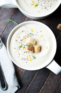 You have to try this silky creamy cauliflower soup with roasted garlic. It's so tasty and you can even make it with almond milk for a dairy-free option. Grab the recipe now and cozy up with a cup of soup on the couch! Roasted Cauliflower, Roasted Garlic, Cauliflower Soup, Chowder Recipes, Soup Recipes, Garlic Soup, Garlic Head, Almond Milk Cheese, Gastronomia