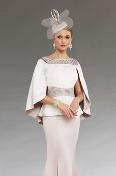 This full length dress features a peplum style waistband that creates a more flattering silhouette. The matching cape drapes elegantly over the shoulders. This dress is also available in a knee length version. Mother Of The Bride Fashion, Mother Of Bride Outfits, Mother Of Groom Dresses, Brides Mom Dress, Mothers Dresses, Vestidos Marisa, Mob Dresses, Wedding Dresses, Prom Outfits