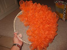 Fleur de lis and Football: DIY pumpkin wreath. Going to use this to make a snowman wreath.DIY Pumpkin Wreath - embroidery hoop, latch hook canvas (could use plastic canvas), and deco mesh ribbon. Other supplies - pipe cleaners for attaching the mesh Fall Crafts, Holiday Crafts, Holiday Fun, Diy Crafts, Favorite Holiday, Christmas Diy, Holidays Halloween, Halloween Crafts, Halloween Decorations