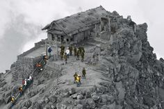 Rescuers at a shrine near the summit of Mt. Ontake, the volcano which erupted last month