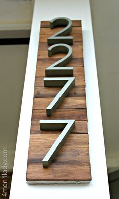 Modern house numbers. Wood backing slats are made from paint stir sticks that you get free from your paint store.