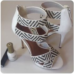 """MICHEAL ANTONIO BLACK & WHITE HEELS Classic white Micheal Antonio 4"""" heels with back zipper, open toe & black textured woven design in the straps. The shoes are comfortable given the height & no platform. The shoes are in very good condition & worn a couple of times as shown by the sole condition. Lifts & soles have very little wear. Comes in shoe box & true size 7. Micheal Antonio Shoes Heels"""