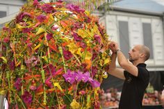 Floral Designer adding finishing touches at Chelsey Flower Show
