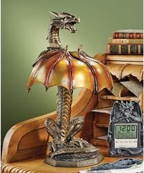 "This broad-shouldered, serpent-like dragon exhibits powerful bravado as spiny wings fan into the translucent shade of this absolutely distinctive illuminated sculpture! In a unique combination of cold cast and quality crystalline resin, ""Dragon Strike"" reflects a Gothic glow across its painstakingly hand-painted, antique bronze finish. Accepts your 25-watt, type-B candelabra bulb; switch on cord."