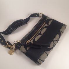 COACH Black logo clutch with strap Gorgeous and in excellent condition- one very minor Mark, as shown in 3rd pic. Make an offer Coach Bags Shoulder Bags