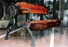 Iron and log bench