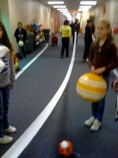 How far away are the planets? Using toilet paper to help kids understand the concept.