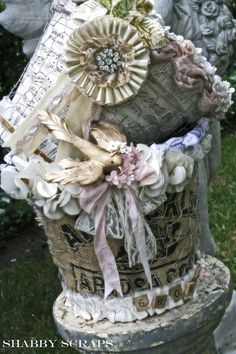 No tutorial bit I love these flower pots covered in burlap, old sheet music, chicken wire and then dressed up!!