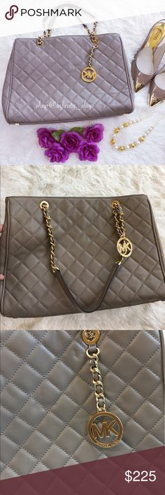 Michael Kors Susannah  Quilted Large Tote Handbag is made of luxe quilted lamb leather. Finished with gleaming gold chain accents. Interior features one zip divider pocket, one zip pocket, 3 open pockets , one cellphone pocket and key. Double top handles with magnetic closure, lined zip compartment, interior zip pocket, four interior slip pockets. COLOR : DARK TAUPE Michael Kors Bags Totes