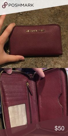 Merlot continental wristlet Michael Kors MK wallet in merlot - a dark burgundy maroon color! wanting to trade for a pale pink, rose jade, blush colored kate spade wallet :) Michael Kors Bags Wallets