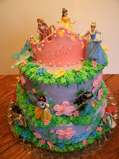 Disney Princesses 2nd Birthday cake! All buttercream, with candy clay butterflies and tiara! The Princesses are for Princess Emma to keep and play with! The flowers were made to match the invitation! :) https://www.facebook.com/angelas.cakes2011