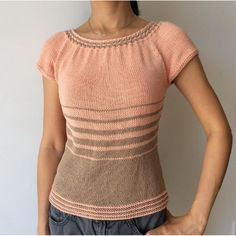 This is a very feminine standard fitting top. It features woven cable neckband, internal waist shaping and stripes. This top is worked in the round from top down. Skills required:Long tail cast onBeginner level cable knitting skill (4 stitches cable)Working top down raglan constructionKnitting small circumferences in the round (for the sleeves edging)