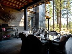 Designed to take advantage of the forest, golf course and mountain views beyond, this outdoor kitchen and dining space provides a central, stylish spot to enjoy the natural beauty of Truckee Tahoe.