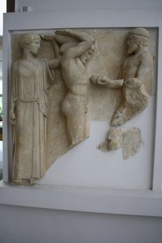 Hercules and Atlas  Metope from the east side of the temple of Zeus, Olympia. Here Hercules holds the Earth on his shoulders with the aid of Athena, on the right Atlas gives the Apples of the Hesperides. (470-460 BCE) Olympia Archaeological Museum.