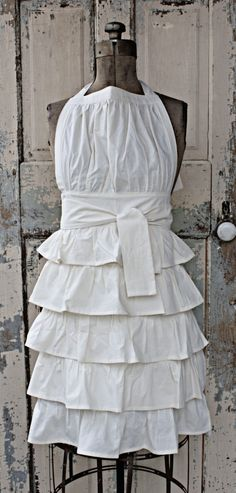 Ruffled Apron. $58.00, via Etsy. http://www.etsy.com/listing/47066802/ruffled-apron?ref=sr_gallery_9_search_query=apron_search_type=handmade_page=[]=tags[]=title