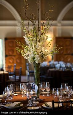 look of tables in reception, combination of orchids, lilies and roses. Hydrangea omitted due to heat limitation. $175