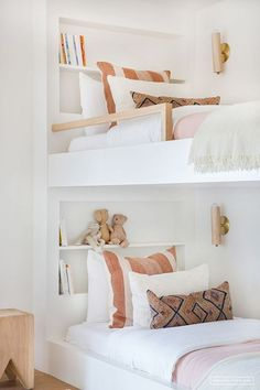 Scandinavian Modern Cabin in Venice Beach – Stace King with modern bunkbeds and boho pillows, modern boho kid room decor, shared kid room with custom bunk beds, vintage shared girl room decor, neutral shared girl room wiht custom built ins