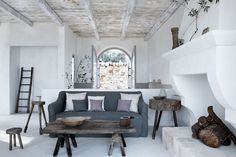 Masters of mood and ambi3nce, Alexander Waterworth Interiors combine muted colors with rough-hewn antiques to create magic in a 17th century masseria in Southern Italy.
