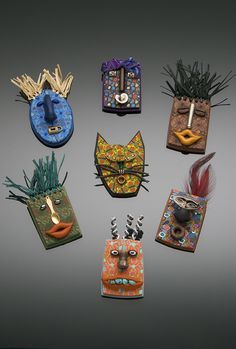 mini mask brooches - clay? wood? cardboard? recycled elements as well