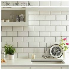 The beveled subway tile ads a little more interest. Love it with the gray grout and white countertop! Source