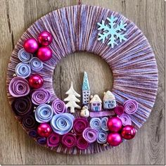 Modern take on a Christmas wreath... Cute and flat enough to fit between the storm door and front door...