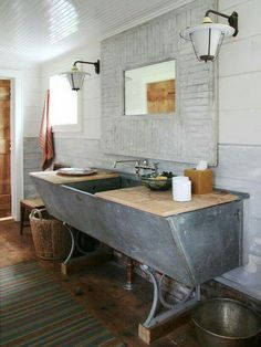 Repurposed trough turned into sink. Nice for laundry room
