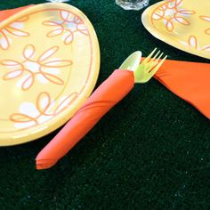 Green utensils with the orange napkins. Found matching egg-shaped plates and bought some indoor-outdoor carpet cut to the size of my table for the tabletop.