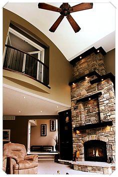 Corner Kitchen Behind Living Room With Corner Fireplace