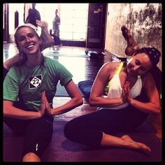 Legs behind head with yoga buddies