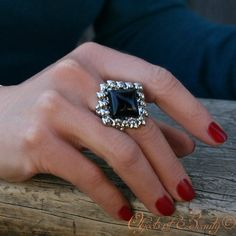 """Helena Ring - Oh Helena, full of fire and forgetful.  Whatever have you gotten yourself into now? Hopefully you're having fun, whatever it is! Helena Black Onyx Liquid Metal Bracelet is available in Sizes: 5-9 She Measures Width: 1.5"""" Made in the USA."""