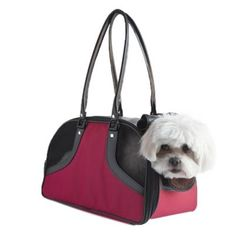 Petote Roxy Bag is a classic design pet carrier. The Roxy Bag is great for travel as well as for toting your dog around town. The Roxy Bag is available in 2 sizes. Size Small Roxy Bag is airline approved on most airlines. Petote dog carriers and pet ...