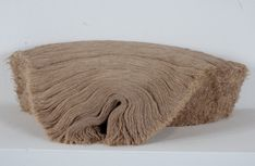 Kate Carr's sculptures incorporate hand cut textiles in organically formed patterns