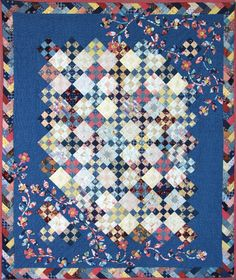 Nine patch quilt with floral applique and French braid border. by Elissa Barbieri's mother-in-law; posted at Clothworks