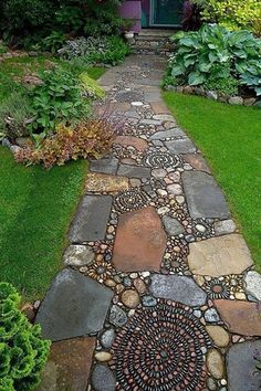An abstract path of river-stone mosaic swirls and flagstone lead up to a home that suggests an equally whimsical interior.