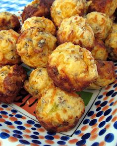 Sausage & Cheese Muffins #recipe  1 lb hot sausage, uncooked  8 oz cream cheese, softened  1 1/4 cups Bisquick  4 oz cheddar cheese, shredded    Preheat oven to 400F.    Mix all ingredients until well combined. (I use my KitchenAid mixer with the dough hook attachment)  Roll into 1-inch balls.  Bake for 20-25 minutes, or until brown.