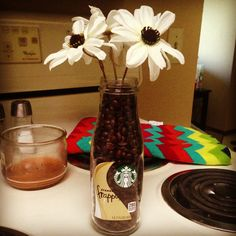 Starbucks bottle with coffee beans with some simple flowers for a cute coffee decoration in the kitchen. #Starbucks #Coffee