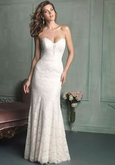 The Allure Bridal Gown 9107 is strikingly demure and simple yet ravishing. The combination of the delicate lace with the stiking silhouette is just outstanding. This figure-slimming strapless gown features all-over lace —and a sheer plunge at the bodice. Covered buttons on the back and a soft sweeping train. Lace and Charmuese Satin