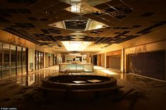 Missouri's Metro North Mall in Kansas City - A series of photos - quite possibly the final look inside before being torn down. The apocalyptic images of the Metro North Mallwere captured by by photographer Seph Lawless