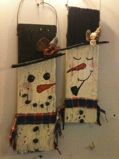 Snowmen made from old pallet wood