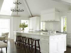 Pure white kitchen with marble counter top - wondering how it would look if the cabinets had a more weathered look.