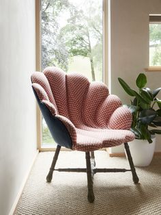 Shell chair upholstered in a patterned fabric on the front and a velvet on the back Devon House, Upholstered Chairs, Wicker, Shells, Velvet, Living Room, Fabric, Furniture, Home Decor