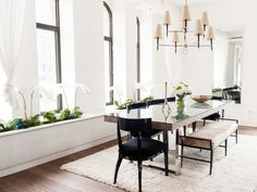 Luxe dining space with white orchids in interior window boxes