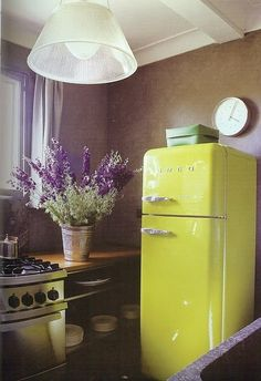 Bright-colored refrigerators (and flowers) add a spark of happiness to any kitchen. #inspiredkitchen