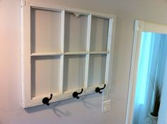 DIY coat rack from an old window with dry erase marker window panes