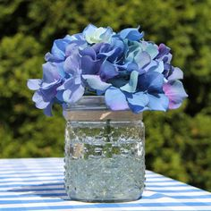 Style Idea: Fill a few Hobnail Mason Jars with Clear Glass Beads, tie them with burlap ribbon and fill with vibrant blue hydrangeas for an easy picnic-inspired centerpiece!