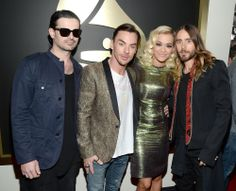 Tomo Milicevic, Shannon Leto and Jared Leto of 30 Seconds with Rita Ora. 2014 Grammys